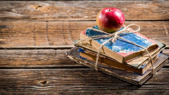 33951343 - old books and apple on school desk