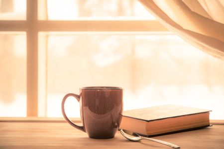 52314615 - coffe and book near window with bright sunny light